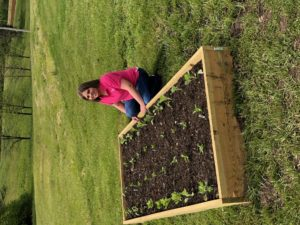 Amanda Royall with her raised bed garden
