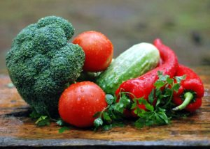 Photo of broccoli, tomatoes, cucumber, and peppers