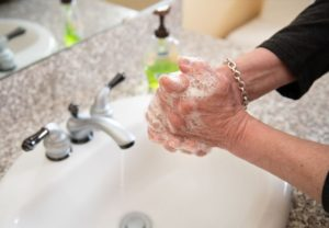 Photo of someone washing their hands.
