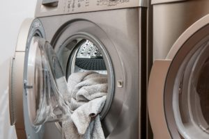 Photo of a front load washing machine with towels