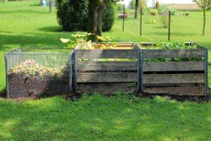 Photo of composting bins in a yard.